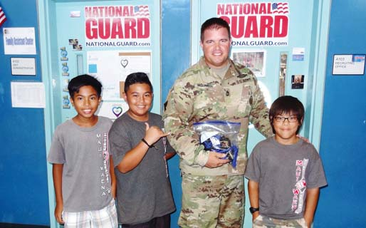 Vincent Mabalot (from left), Delton Pasuca, Sgt. 1st Class Robert McDonnell and Mark Arruiza are shown at the presentation of handmade paracord survival bracelets on Nov. 14.