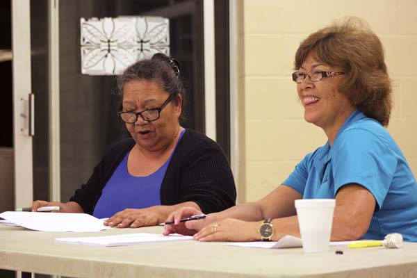 During a public hearing Monday night, Blossom Feiteira (left), president of the Association of Hawaiians for Homestead Lands, gives her opinion on rule changes proposed by the Department of Hawaiian Home Lands, alongside Pua Canto, who holds the Maui seat on the Hawaiian Homes Commission. The Maui News / COLLEEN UECHI photo