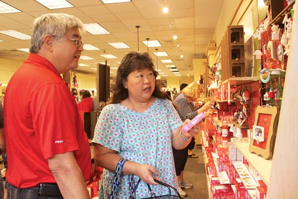 Shoppers line up early for post holiday deals news Amys hallmark