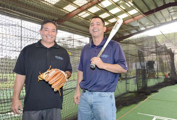 Dean Yamashita (left) and Craig Okita, former opponents on the diamonds of their youth, are coaches for the All Pono Organization. They teach more than baseball to their young players; they use the game to offer lessons about life.  The Maui News MATTHEW THAYER photo