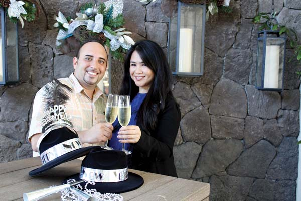 Michael Gaal and Lani Clarion of The Ritz-Carlton, Kapalua Food & Beverage team toast to upcoming New Year's events.  The Maui News / CARLA TRACY photo