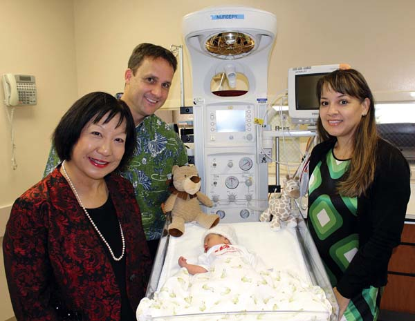Sharon Suzuki (from left), Rian DuBach and Lisa Varde pose with baby Rhett-Louis DePonte in one of the new Panda Infant Warmers.