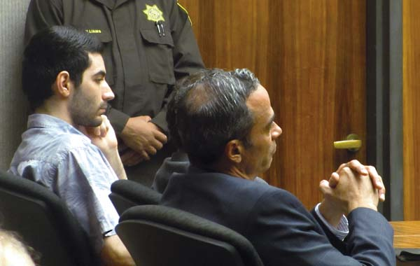 Convicted murderer Steven Capobianco and his attorneys, Matthew Nardi (partially obscured) and Jon Apo (right), wait for the 2nd Circuit Court jury's decision to be announced Tuesday in the second phase of Capobianco's murder trial. The Maui News / LILA FUJIMOTO photo