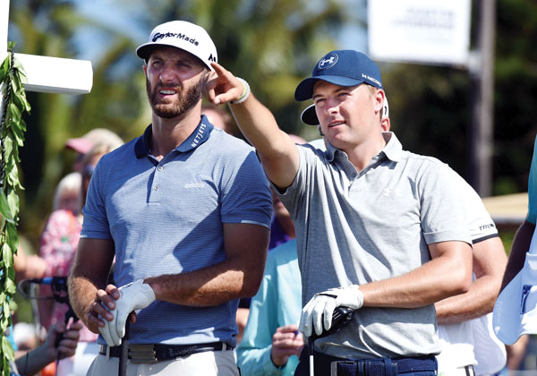 Jordan Spieth points out a humpback whale swimming offshore as he and playing partner Dustin Johnson wait to start their round. The Maui News / MATTHEW THAYER photo