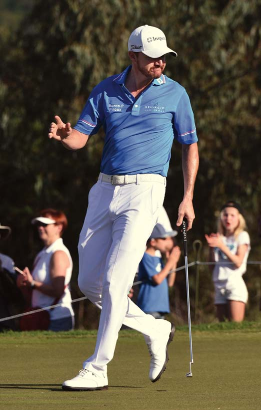 Jimmy Walker acknowledges the gallery's applause.   The Maui News / MATTHEW THAYER photo