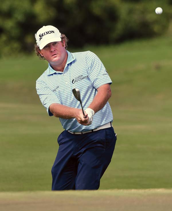 William McGirt chips to the Kapalua Plantation Course's ninth green Saturday during a round of 7-under-par 66 that was tied for the day's best.  The Maui News / MATTHEW THAYER photo