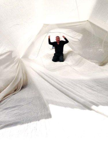 Japan's Akihiko Izukura (left) sits inside a tunnel made of silk.   Photo courtesy Maui Arts & Cultural Center