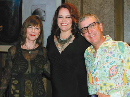 Maui singing superstar and wine proprietor Amy Hanaiali'i (center) at a meet 'n' greet in her new Hawaiian Room at Grand Wailea on New Year's Eve with Rick Cooper (right), owner The Alex Cooper Project Wines, and Bonnie Feinerman.  The Maui News / CARLA TRACY photo