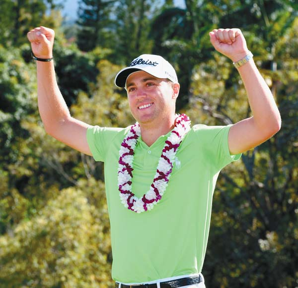 Thomas raises his arms while describing how it feels knowing he's eligible to return to Kapalua next year. The Maui News / MATTHEW THAYER photo