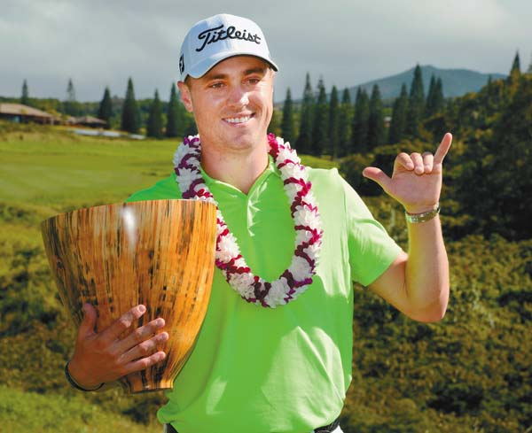 Justin Thomas gives a shaka while holding the SBS Tournament of Champions trophy Sunday at the Kapalua Plantation course after winning the tournament by three strokes. The Maui News / MATTHEW THAYER photo