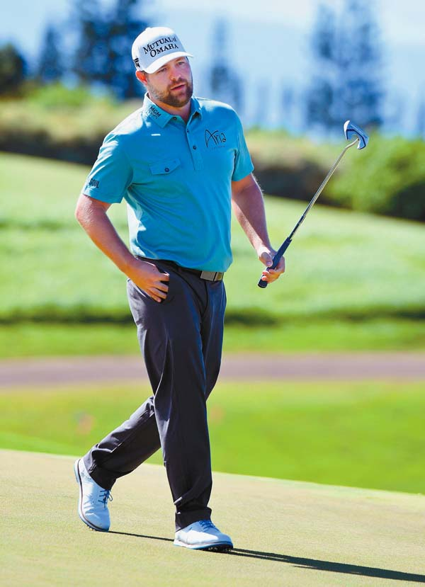 Ryan Moore walks toward his ball on 13th green. The Maui News / MATTHEW THAYER photo