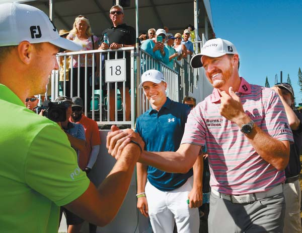 Jimmy Walker (right) and Jordan Spieth congratulate Thomas after his win. The Maui News / MATTHEW THAYER photo