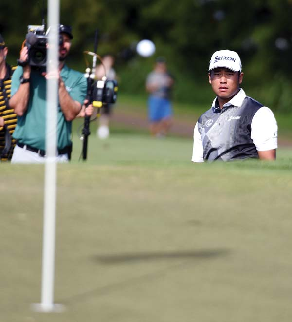 Hideki Matsuyama, shown watching his chip shot for eagle on the Kapalua Plantation Course's 14th hole Sunday, leads the FedEx Cup standings and is ranked sixth in the world. The Maui News / MATTHEW THAYER photo