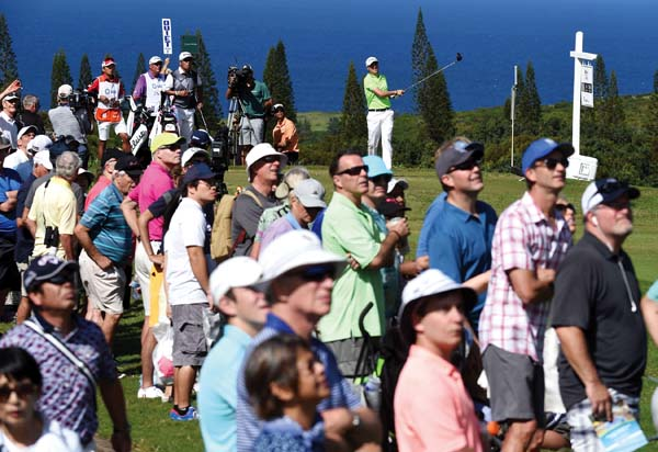 Justin Thomas hits off the Kapalua Plantation Course's 16th tee Sunday on the way to winning the SBS Tournament of Champions. The Maui News / MATTHEW THAYER photo