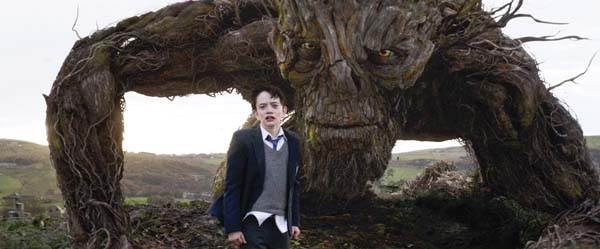 "Lewis MacDougall appears with The Monster, voiced by Liam Neeson, in ""A Monster Calls."" Focus Features photo via AP"