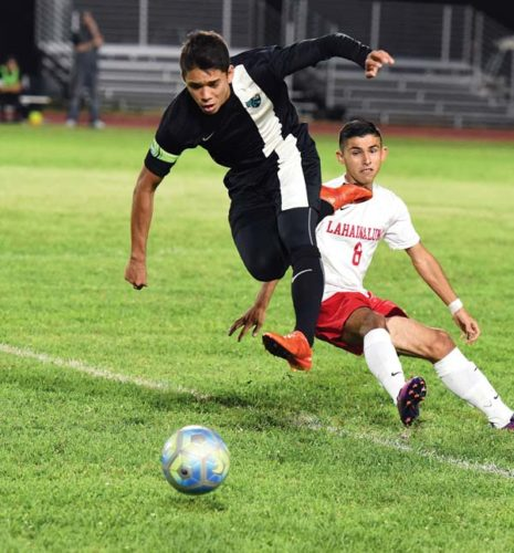 King Kekaulike High School's Collin Miller leaps over Lahainaluna's Marcos Lopez during the first half of Na Alii's 1-0 victory over the Lunas on Thursday at King Kekaulike Stadium. The Maui News / MATTHEW THAYER photo