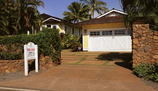 This quaint three-bedroom, 1,700-square-foot house on Front Street in Lahaina is listed at $2.25 million. The median price of a single-family home in Maui County in December hit $700,000 for the first time since 2006. This photo was taken Thursday.   The Maui News / MATTHEW THAYER photo