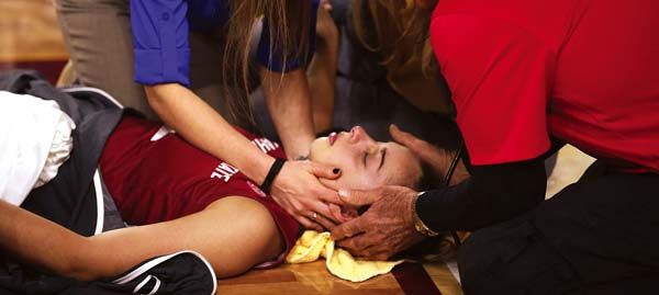 Washington State's Cameron Fernandez is tended to by medical staff after being hurt during a game Friday.  AP photo