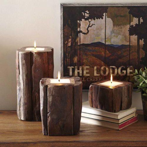 "Birch Lane teak candleholders can create a sense of ""hygge,"" Scandinavian-style coziness, ease, conviviality and a warm glow.  Birch Lane photo via AP"