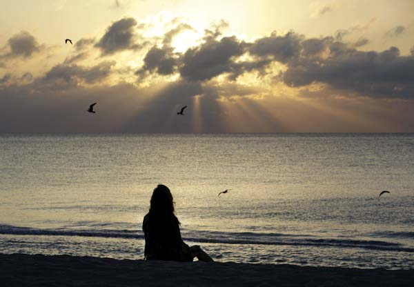 Being  mindful can ease many ailments,  and some money  experts  say it can help with  finances, too.  AP file photo