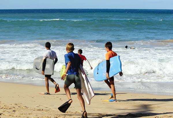 The Junior Men's Division heads for the waves at an earlier Pa'ia Bay Beachfest. The 20th annual event will take place Saturday and Jan. 22 on the beach side of the Pa'ia Youth & Cultural Center.