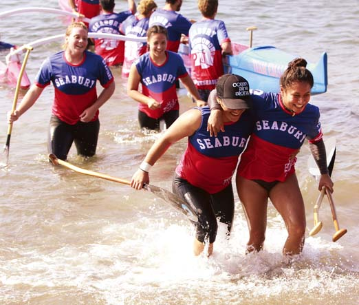 Seabury Hall's Hiilei Luuwai (right) and Nanea Andrade head to shore in front of Kaila Medeiros (left) and Shea Stisher after  winning the Maui Interscholastic League girls title Saturday at Hanakao'o (Canoe) Beach Park.  The Maui News / CHRIS SUGIDONO photo