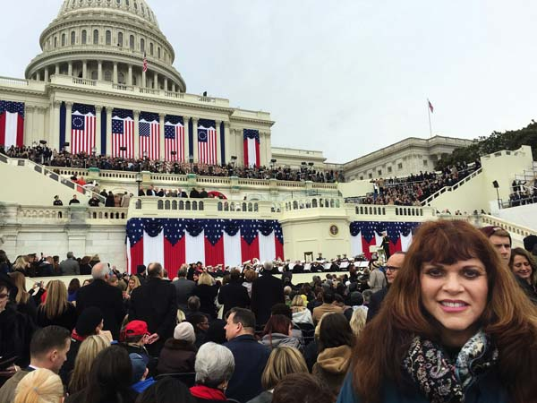 Kihei resident Cindy Sue Clark poses in front of the U.S. Capitol on Friday before the inauguration of Donald Trump. Clark was one of around 12 Maui residents known to be in attendance at the event. The temperature in Washington, D.C., on Friday was about 40 degrees.   Photo via Cindy Sue Clark