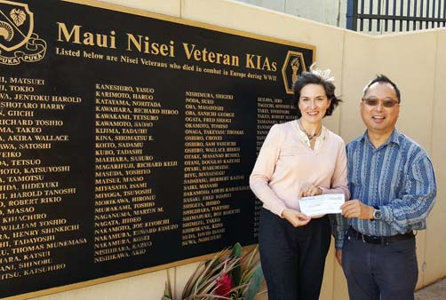 Nisei Veterans Memorial Center Executive Director Deidre Tegarden and President Brian Moto display a check for $85,000 from Maui AJA Veterans Inc.