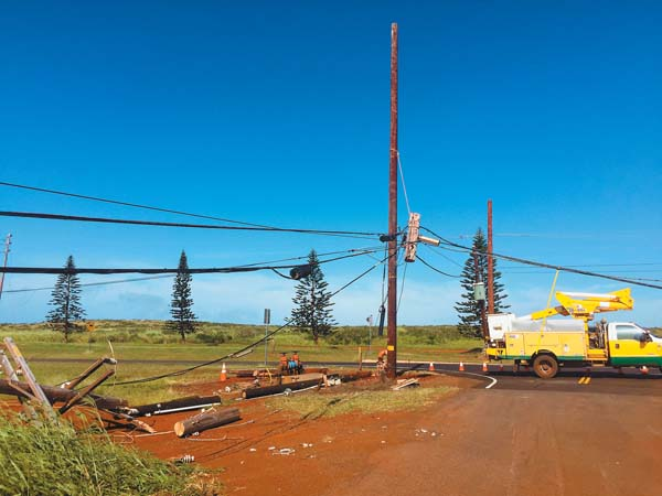 Strong winds knocked down 19 power poles on Lanai on Saturday. On Sunday, the island was without electricity and landline phone services. Maui Electric Co. photo