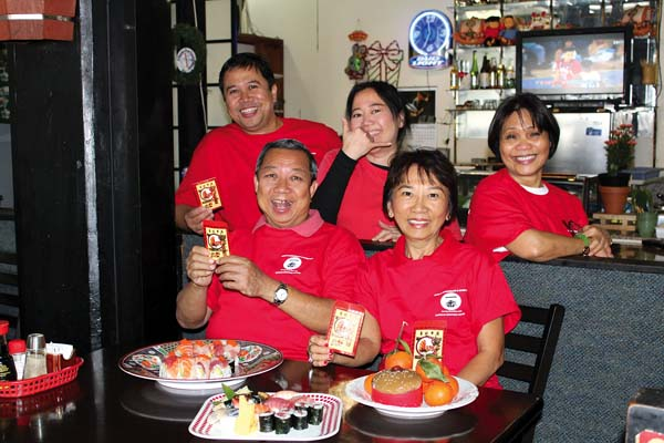 At Ichiban Restaurant & Sushi Bar in Kahului, owners Henry and Patsy Chan showcase their specialties in the front row as sushi chef Ren Padilla and servers Carol Jaramillo and Anna Pader all relax behind. The Maui News / CARLA TRACY photo