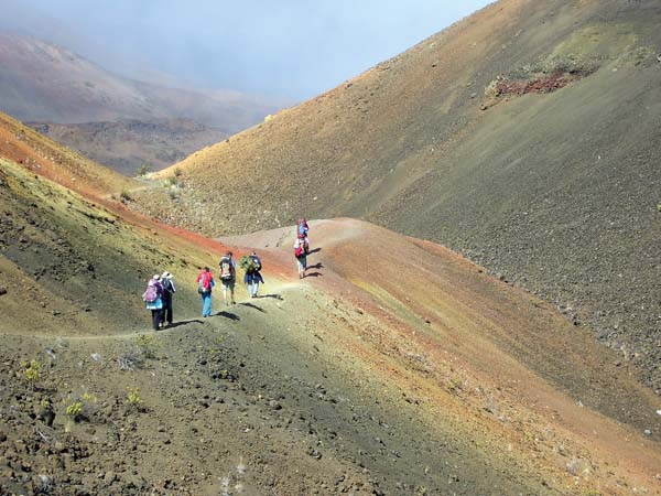 Friends of Haleakala Park volunteers hike through an area known as Pele's Paint Pot. A service trip to the crater is planned from Feb. 18 to 20.