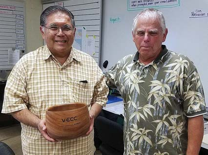 Mel Fukunaga (left) receives an engraved bowl in recognition of joining the Volunteer Examiner Century Club by administering his 100th amateur exam session on Dec. 2. He is shown with from Tom Worthington, president of the Maui Amateur Radio Club.   SHAWN BOECKMAN photo