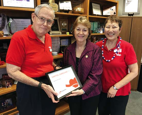 """AARP Hawaii Volunteer State President Gerry Silva (left) and AARP Hawaii State Director Barbara Kim Stanton (right) present state Sen. Roz Baker (center) with a """"2016 Capitol Caregiver"""" award for her efforts to pass the CARE Act last year."""