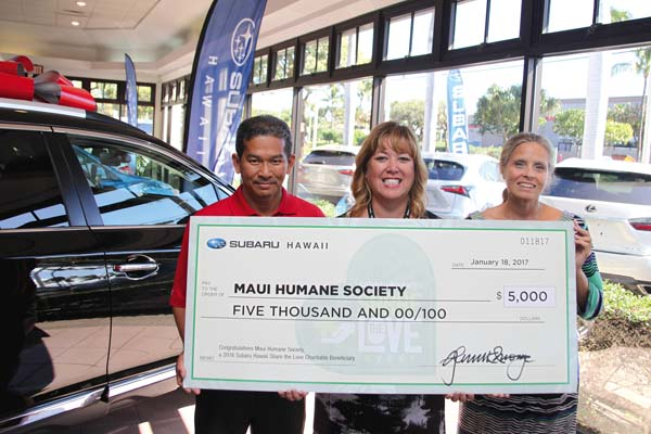 Melan Evangelista (from left) and Judina Hass of Servco Subaru Maui present Nancy Willis of the Maui Humane Society with a check for $5,000.