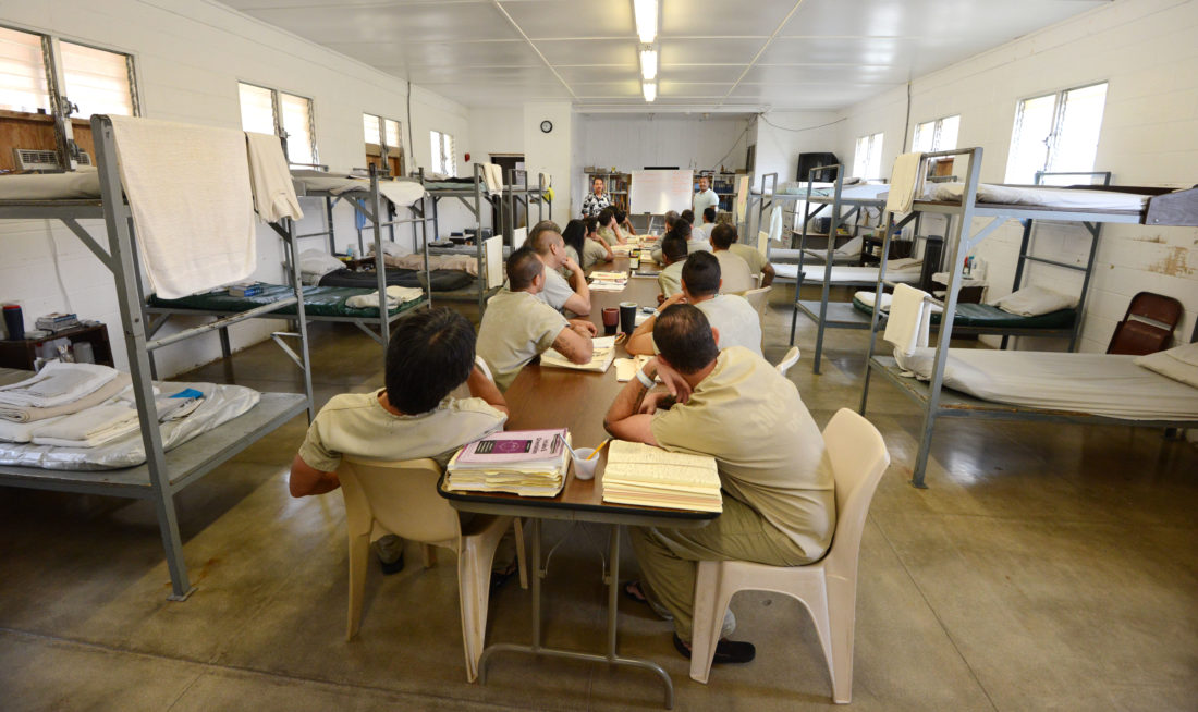 Counselors Armon Tavares and Philip Acang speak to Drug Court inmates in the dormitory-style room where they both study and sleep at Maui Community Correctional Center. The Maui News / MATTHEW THAYER photo