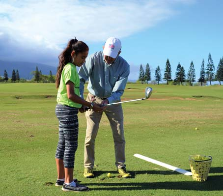 Violet Ferdinant, 10, learns the proper golf club grip technique  from PGA master pro Bill Greenleaf last month. The Dunes at Maui Lani will host the Boys & Girls Clubs of Maui's 11th annual Benefit Golf Tournament on Feb. 18.