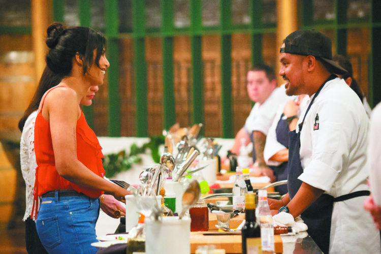 """""""Top Chef"""" host Padma Lakshmi (left) faces Maui's own Sheldon Simeon on the set of Bravo channel's famous food show that will air tonight. Sheldon will be one of four remaining cheftestants. • """"Top Chef"""" photo"""