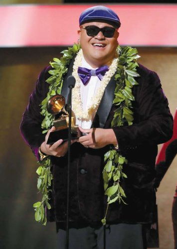 "Maui singer/songwriter Kalani Pe'a accepts the award for Best Regional Roots Music Album for ""E Walea"" during the 59th annual Grammy Awards in Los Angeles on Sunday. AP photo"