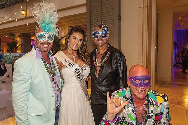 Attendees don masks to get in the Mardi Gras mood as they pose with former Miss Hawaii Flecha Tovar at last year's gala. Adi Ell-Ad of Adiwood Studios photo