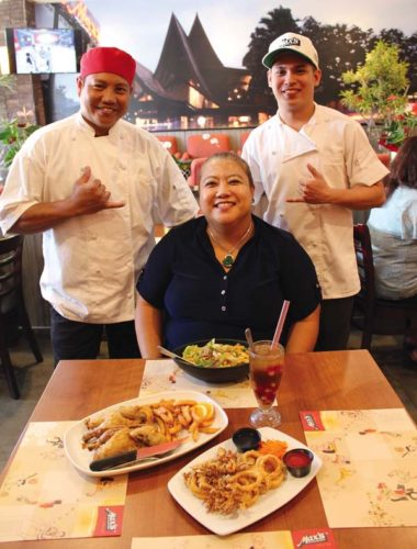 Max's Restaurant branch manager Judith Tomas (seated) is presented with lunch by Chef Erick Buono (left) and chicken processor Edwin Cadungog. Max's Restaurant photo