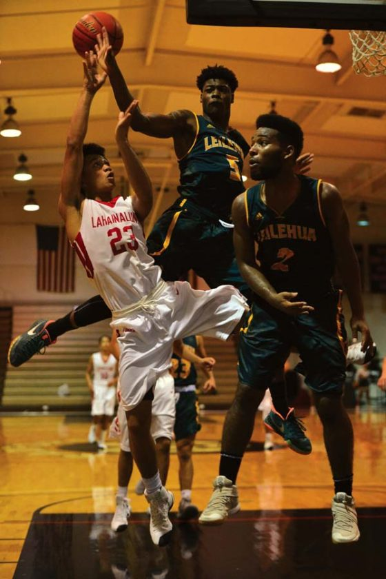 Lahainaluna High School's Jeremi Santos shoots as Leilehua's Trey Boatwright (middle) and TaShaun Wright defend during the Lunas' 44-32 victory over the Mules in a Division I state quarterfinal game Wednesday at the Radford gym. GLEN PASCUAL photo