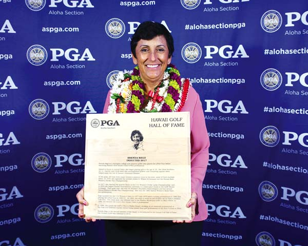 Brenda Rego holds up her Aloha Section PGA Hall of Fame plaque Saturday at an induction ceremony at the Japanese Cultural Center in Honolulu. Aloha Section PGA CHARLEE KAPIIOHO photo