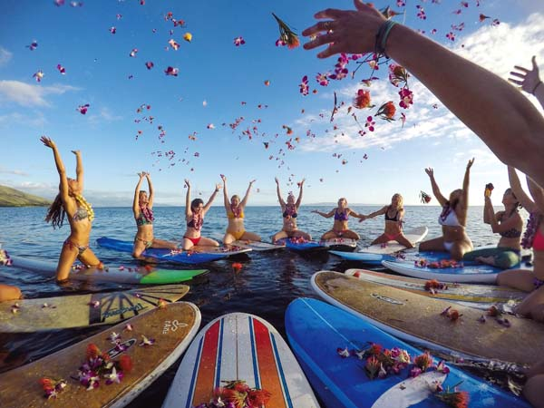 An opening circle kicks off the Maui Surfer Girls winter women's camp last month.  Photo courtesy Maui Surfer Girls