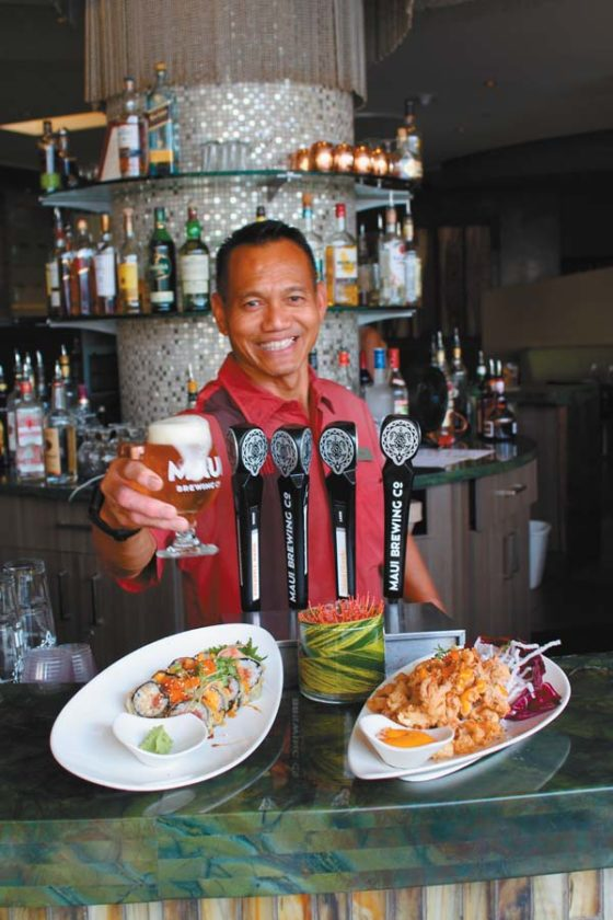 Bartender Ness Ibuos at Fairmont Kea Lani's signature Ko restaurant pours a Cristom Barrel Select that is aged in pinot noir wine barrels from Oregon.   The Maui News / CARLA TRACY photo