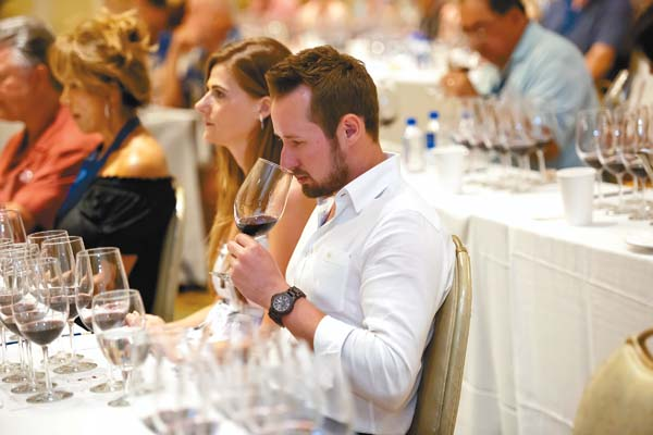 Attendees swirl and sniff before tasting fine varietals at last year's Kapalua Wine & Food Festival daytime seminars at The Ritz-Carlton, Kapalua. Tickets are now on sale for the June 8 to 11 event.   Kapalua Wine & Food Festival photo