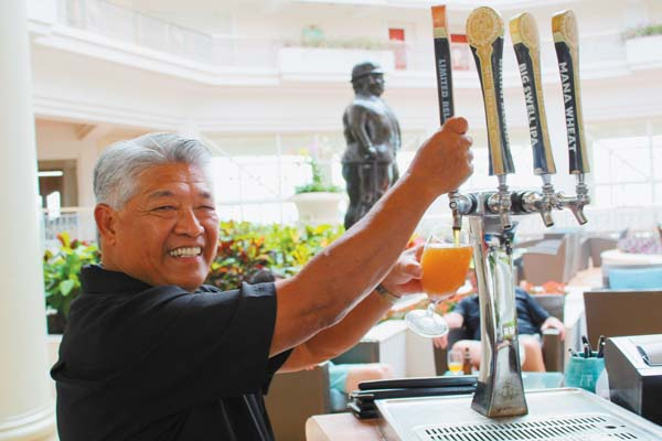 """Longtime Botero Lounge bartender Mich Domingo pours a Grand Wailea Gose (pronounced """"goh-suh"""") at the resort. It evokes a taste of the islands, and is one of Grand Wailea's most requested beverages.   The Maui News / CARLA TRACY photo"""