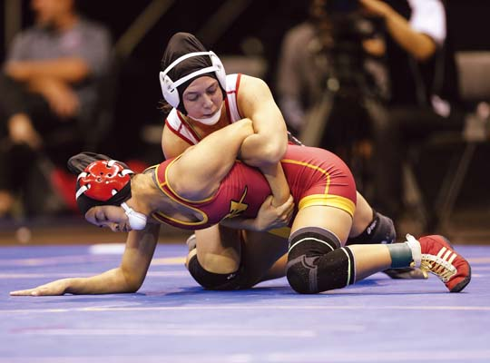 Alexis Encinas of Lahainaluna High School heads to a win over Roosevelt's Macy Higa in the Chevron State Wrestling Championships 112-pound final Saturday at the Blaisdell Arena.   Hawaii Media Source / MATT HIRATA photo