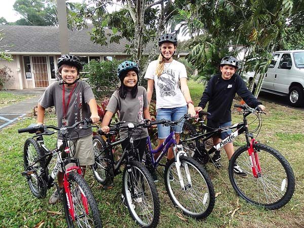 Zedekiah Yadao-Rurbianes (from left), Stephanie Blanza, Savannah Aroyan and Kanoa-Justis Blue are shown with new bikes provided via a donation from members of the Business Network International No Ka Oi Chapter. Aroyan is a Maui Youth & Family Services counselor and the three kids are MYFS participants.
