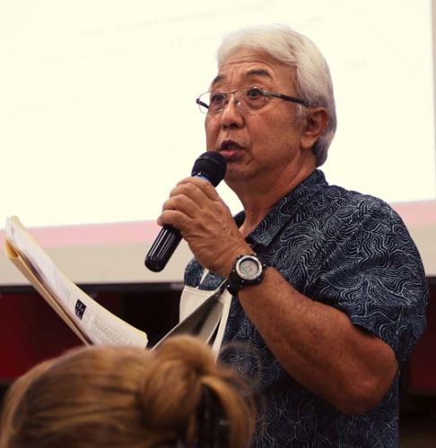 Pukalani resident Jerry Masaki testifies against sewer rate increases proposed by Hawaii Water Service Co. during a Hawaii Public Utilities Commission hearing Thursday night at Pukalani Elementary School.   The Maui News / CHRIS SUGIDONO photo