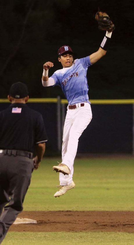 Baldwin High School's Kaipo Haole leaps to haul in a throw during the first inning of the Bears' 3-2, 10-inning win over Kamehameha Maui on Saturday at Maehara Stadium.  The Maui News / CHRIS SUGIDONO photo